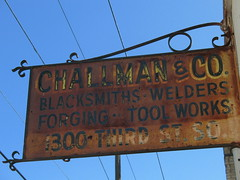 Challman & Co. Blacksmiths (Stevesworldofphotos) Tags: blue sky minnesota sign metal mural day minneapolis sunny blacksmith lakestreet welders forging toolworks powderhornparkneighborhood challmanco 1300thirdstreetsouth