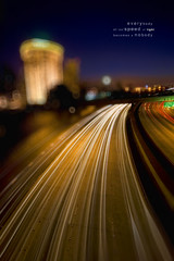 L i g h t  S p e e d (Lee Sie) Tags: city longexposure urban night lights nikon downtown traffic sandiego bokeh circles handsfree overpass diego wideangle headlights spots freeway speeding fastlane offramp lightspeed sigma1020 d40 imadethatup fapfenceaerialphotography bokehatf22 lpurban
