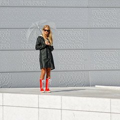 rainy season in Norway (williwieberg) Tags: girl sunglasses oslo norway umbrella opera blond d3 redboots 70200mmf28gvr oslooperahouse