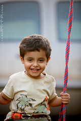 Children smile back us to the life (Abdullah.N.KH) Tags: ocean sunset sea portrait abstract building nature colors smile silhouette sunrise canon landscape sadness waves 300d desert natural happiness wideangle nassir abdullah oldhomes  khamees 5dmark2 mark|| abdullahnasser