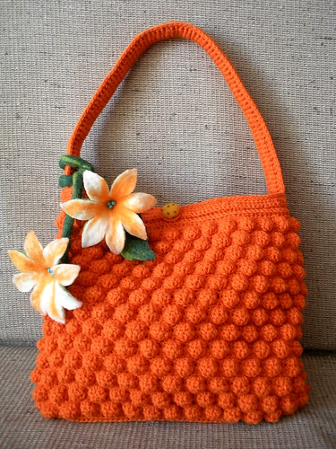 Orange crocheted purse with felted flowers