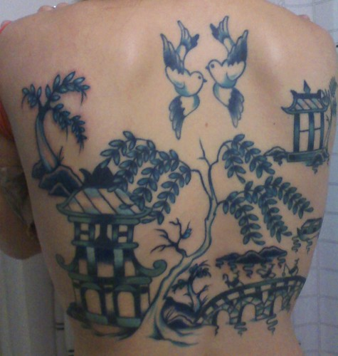 Tattoo Picture and Bird Tattoo on the Back