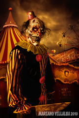 CREEPY SHOW BY MARIANO VILLALBA 2009 (Mariano Villalba) Tags: sunset red house halloween argentina colors yellow photoshop dark fun blood circus clown knife carnivale horror terror macabre mariano villalba