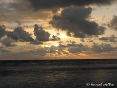 Sunset at Tarkarli.. (Learning to Click..) Tags: eve light sea sun sunlight india beach water clouds evening dusk rays sunet tarkarli