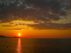 Sun setting low ... (pantherinia_hd Anna A.) Tags: trip travel sunset sea vacation sky sun seascape reflection beach colors beauty clouds reflections relax landscape island sand scenery europe mediterranean tramonto sightseeing aegean scene serenity rays relaxation rodos rhodes rodi topseven platinumheartaward artofimages bestcapturesaoi mygearandme mygearandmepremium tramondi