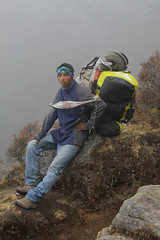 Porter at Rest (cormend) Tags: travel nepal portrait brown mist rock trekking trek canon eos asia hiking jeans trail backpack rest resting himalaya load porter khumbu everest sherpa carry headband gokyo 50d cormend