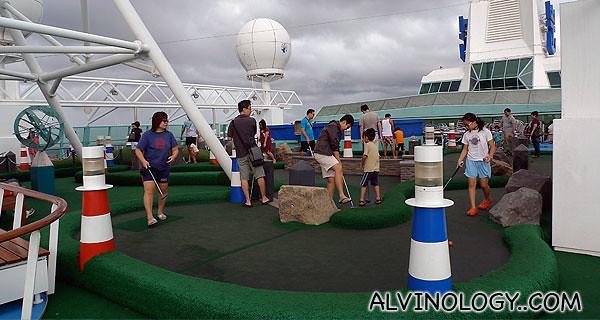 Other passengers playing mini golf