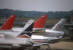 Tails from Gatwick- 1990 (Longreach - Jonathan McDonnell) Tags: nikoncoolscanved scan scanfromaslide london 1990s 1990 londongatwick delta deltaairlines lockheed lockheedtristar aa americanairlines dc10 northwest northwestairlines boeing 747 459002 20091990 n1739d