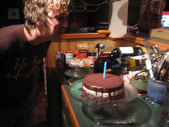 trevor blowing out his candle
