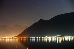 Bay of Kotor (iananovich) Tags: blue sky orange white mountains water silhouette night dark stars lights shine shining montenegro perast bayofkotor