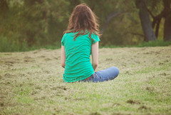 day two. (more in comments) (raychel sonveeco.) Tags: girl grass sitting sad young windy teenager 365 55200mm nikond60