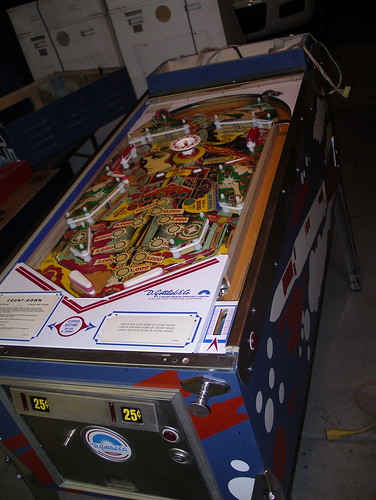 playfield, coin door, and plunger