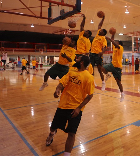 In the span of a second, a player dunks during the Manchester Millrats free agent camp.  Photo by Chuck Miller.