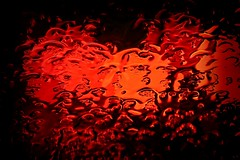 the searing rain:  299/365 (helen sotiriadis) Tags: street light red abstract black water glass car rain canon dof traffic bokeh depthoffield explore 365 windshield frontpage canonef100mmf28macrousm canoneos40d toomanytribbles dslrmag