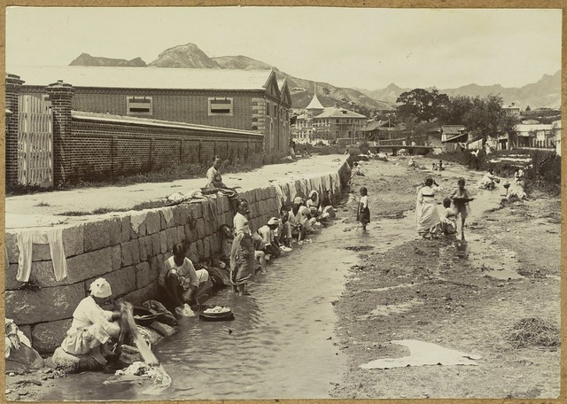 [Women washing laundry in stream]