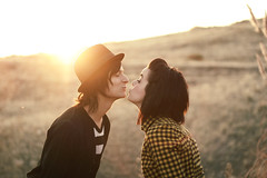 once upon a time... (Tim Riley | trileyphoto.com) Tags: sunset sun sunlight man cute beautiful hat lady riley tim kiss bokeh happiness lips flannel expressive amazingcolors sunflare timriley trileyphotocom