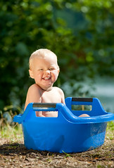 Alfresco bathing (Dmitri Naumov) Tags: life baby cute nature water girl face childhood smiling fun happy person one healthy bath toddler infant sitting child open natural emotion little outdoor good expression air small joy daughter lifestyle clean health wash enjoy bathe environment bathtub positive bathing care cheerful comfort joyful having healthcare hygiene pleasure alfresco caucasian