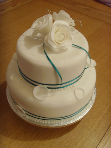 Two tier white rose wedding cake