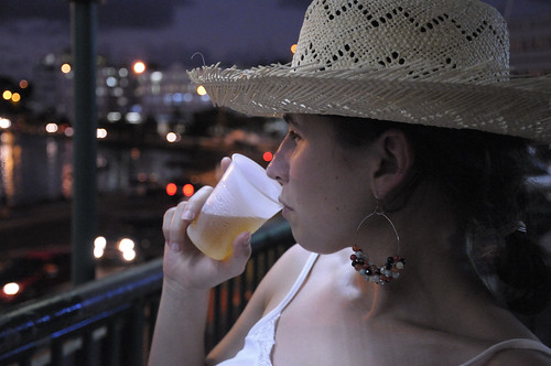 Forced to drink rum in her new hat.  Is that any way to treat a tourist?