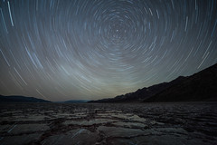 Star Trail Reflections on a Windless Night II (Kurt Lawson) Tags: badwater basin black california copyrighted death deathvalley mountains national nationalpark night park reflection salt silhouette sky startrails stars valley water