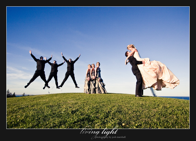 Bridal party jump for joy in sweeping ocean views. King Edward Park. Newcastle wedding photography.