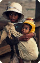 Chicken Village babysitter Vietnam. (bkiwik) Tags: girls baby cute wool hat kids sisters digital canon asian happy photo kid amazing hugging eyes hug asia village photos sister 10 group poor vietnam sling million babysitting babysitter beanie cardigan the chickenvillage eos400d selftaughtphotographers