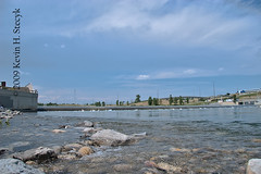 Bow River Submerged Weir (Stecyk) Tags: ca trees canada calgary bike river geotagged pelican canoneos20d alberta biking pathway bowriver weir 3514 canonefs1785mmf456isusm submergedweir harviepassage geo:lat=51042497 geo:lon=11401327