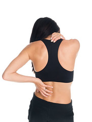 woman - neck and back pain (dgilder) Tags: people woman usa black beautiful female austin person pain pretty texas adult whitebackground massage attractive studioshot workout stress isolated 30s 20s sore darkhair backpain neckpain colorimage workoutclothes midadultwomen isolatedonwhite