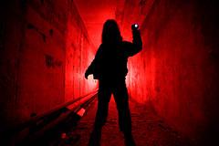 Man in dark tunnel (alexey05) Tags: red portrait man black silhouette vertical mystery danger dark underground dream tunnel adventure fantasy killer flashlight worker concept homicide genre murderer maniac murderess
