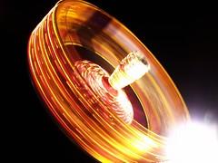 The Cage (Conor Kiwi) Tags: light red orange black night dark fun photography photo ride spin fair cage firework exeter spinning kiwi conor circular gcse kodakeasysharem863 keighery