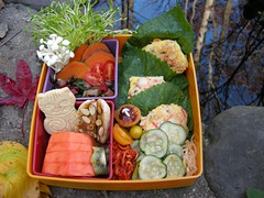 Korean reflections bento (Bentobird) Tags: papaya banana almonds bento sweetpotato kiwi autumnscene enoki rainbowchard cabbagekimchi peasprouts superhmart latenovember koreanfoods sesameleaves bentobird koreancrabandscallioncakes koreanstylecucumberandbeansprouts