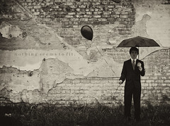 Raindrops Keep Falling... (Brandon Christopher Warren) Tags: old black grass wall sepia umbrella silver dark paint downtown daniel bricks north brandon rocky tie mount suit carolina warren grayscale rockymount onmyhead danielwarren nothingseemstofit raindropskeepfallin bigblackballoon harambeesquare