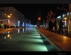 Fountain in the Cluj city center (capreoara) Tags: city winter light night nikon december center romania reflexions 2009 cluj 5photosaday d3000 vanagram