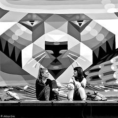 DSCN2715 (Akbar Simonse) Tags: holland netherlands nederland people girls candid streetphotography streetshot straatfotografie straatfoto straat street sitting streetart denhaag thehague agga sgravenhage lahaye akbarsimonse vierkant square squareformat zwartwit bw blancoynegro bn monochrome virus