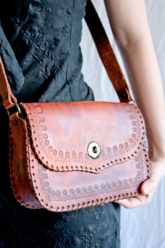 Vintage 1970s brown leather tooled saddle bag