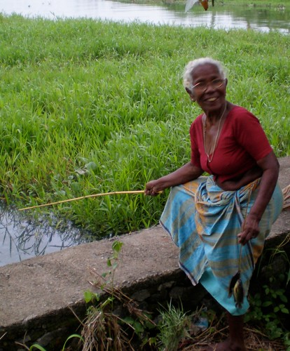 Woman happily catching fish