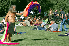 festival fan (zenobia_joy) Tags: seattle park shirtless urban sun sunlight man nature festival hair circle beard grey washington concert long sitting dancing bare chest hill crowd watching skirt september capitol elderly twirl older scarves blankets volunteer decibel 2009 sequin