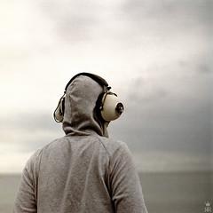 stereo (romanraetzke) Tags: sea portrait man male film analog mediumformat hoodie kodak felix stereo squareformat mann kiev portra ostsee 6c farben kopfhörer kapuze 160nc mittelformat