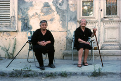 OLD LADIES in LARNACA CYPRUS (Garo Berberian) Tags: old ladies smile contrast nikon group national kodachrome frown geographic larnaca berberian fe2 garo nationalgeographicgroup travelon5photosaday streetpassionaward