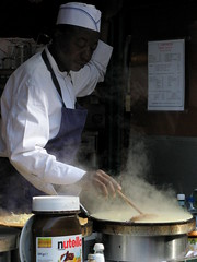 Master crepe-maker (suvodeb) Tags: travel urban holiday paris france travelling cooking beautiful europe cityscape cook cities illumination montmartre historic steam traveller master chef crepe pan nutella maker crepes frying gallic crepemaker crepier