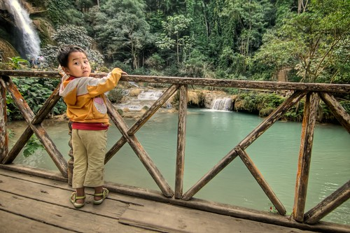 Kid at Kuang Si Waterfall