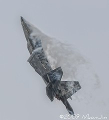 F-22 Raptor Accelerates Vertically (nikonjim) Tags: plane action aircraft airshow explore rhodeisland raptor f22 usaf quonset d300 unitedstatesairforce watervapor flighter explored demonstrationteam f22a 300mmf4d aircombatcommand platinumphoto northkingston nikonjim