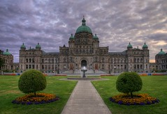The British Columbia Legislature or Parliament Buildings (HDR) (Brandon Godfrey) Tags: world pictures old city flowers windows sunset summer urban canada building fountain beautiful grass clouds wonderful landscape photography gold photo amazing fantastic scenery day bc shot cloudy photos shots pics earth path britishcolumbia sony lawn picture overcast parliament pic scene images victoria symmetry creativecommons pacificnorthwest northamerica unreal alpha dslr 1001nights legislature 2009 hdr highdynamicrange victoriabc jamesbay innerharbour outstanding a300 photomatix copperroof tonemapped tonemapping bclegislature photomatrix captaingeorgevancouver mywinners bcparliamentbuildings singlerawfilehdr platinumheartaward thechallengegame challengegamewinner dslra300 sonya300 100commentgroup
