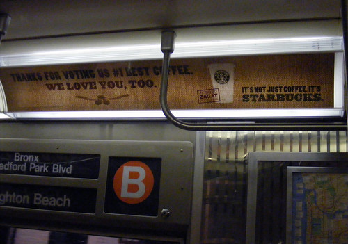 "Starbucks ad on the ""B"" train"