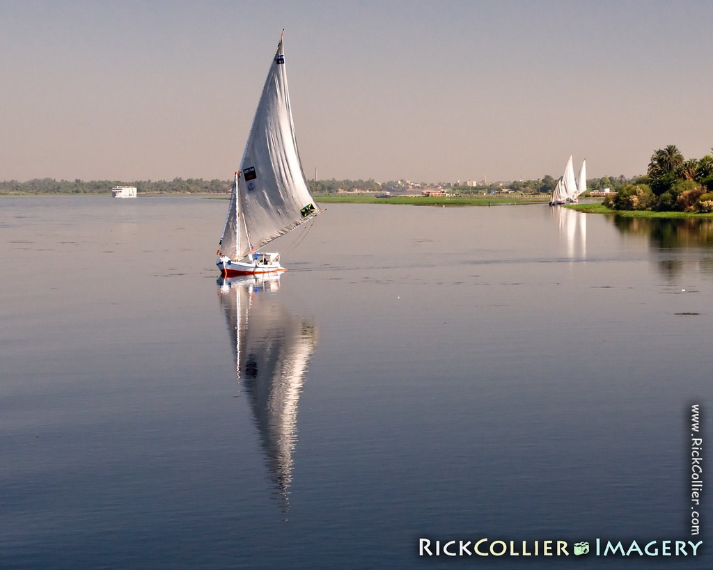 A felucca, followed by two more, sets sail in the morning from a Nile River village south of Kom Ombo