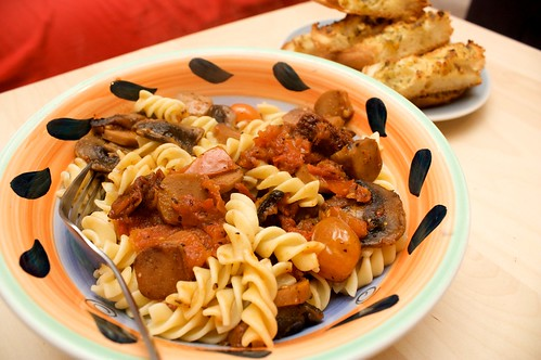 three tomato pasta with mushroom and vegie sausage