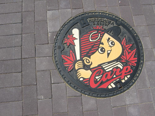 Hiroshima Carp-themed manhole cover.