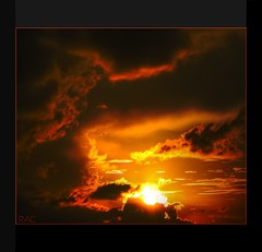 Fire In the Sky (Louie, Lou) Tags: sunset red sky orange sun clouds fire silhouettes hdr rac fireinthesky blazing readyaimclick