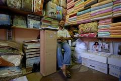 Towel seller (morgan leafy) Tags: africa carpet market muslim islam north eid libya tripoli ramadan gadaffi