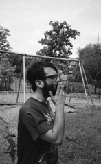 (YAY Fred Mitchell!) Tags: film boys beard birmingham alabama boyz smoking alcohol cigarettes 2008 2009 pointshoot wayfarers raybans olympusstylus c41 kodak400bw pitchforkmusicfestival johnnieb epsonv750pro bestnewmusic tornuptshirt ilovejohnnieb